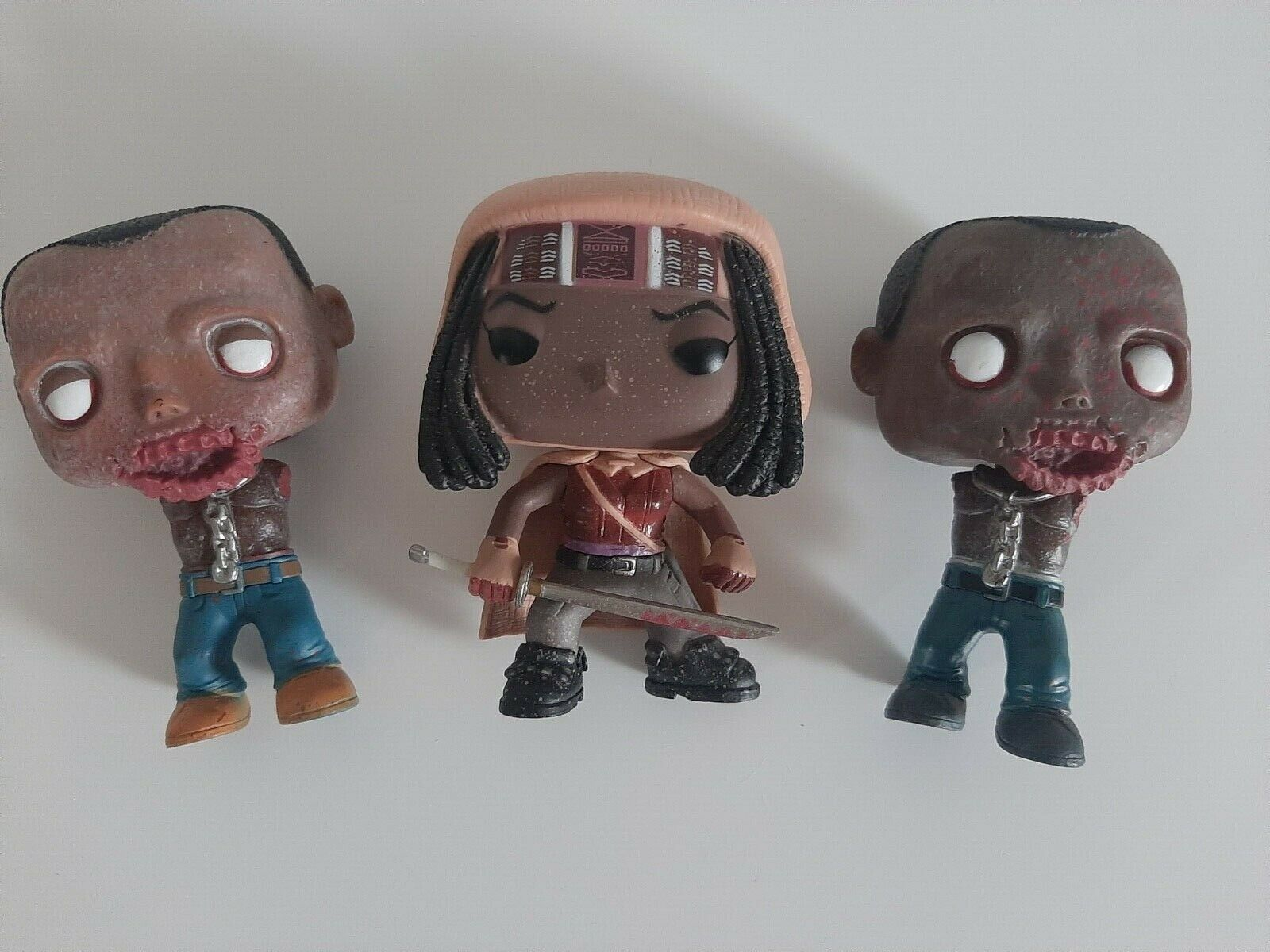 Funko Pop Michonne and her 2 pets