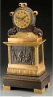 A FRENCH EMPIRE-STYLE GILT AND PATINATED BRONZE MANTEL CLOCK, THIRD... Lot 65598