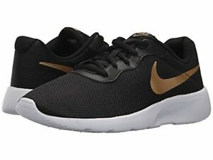 Nike Boys Tanjun Sneakers 4 Boys Youth GS Shoes NIB Black With Gold ... 7b7e01c60