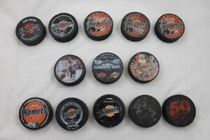 13-Assorted-KOMETS-Hockey-Pucks-Some-Signed-IHL-UHL-ECHL-Fort-Wayne-Ice-Hockey