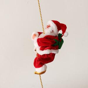Giocattolo bambola di Babbo Natale su arrampicata elettrica per