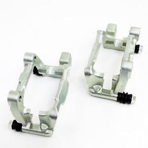 2x-Saddle-Holder-Brake-Calliper-Carrier-Axle-Audi-A3-VW-Caddy-Seat-Ua-1ZE-1LJ