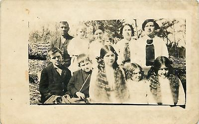 Real Photo Postcard~Family by Fallen Tree~Daughters Have Long Wavy Braids~c1913