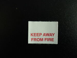 KEEP AWAY FROM FIRE  clothing garment warning labels