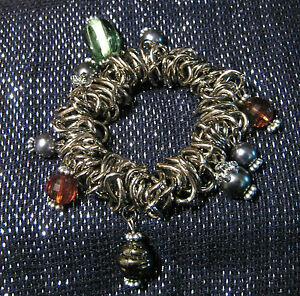 Elasticated-bracelet-with-silver-coloured-decoration-and-lots-of-beads