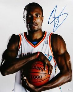 serge ibaka autographed 16x20 holding basketball photo jsa