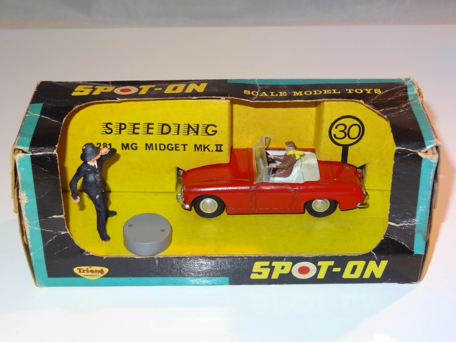 (V) triang spot on SPEEDING MG MIDGET WITH POLICEMAN  - 281