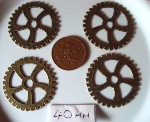 4 STEAMPUNK COGS//GEARS EACH PIECE IS 40MM  AND IS BRONZE IN COLOUR  METAL ALLOY