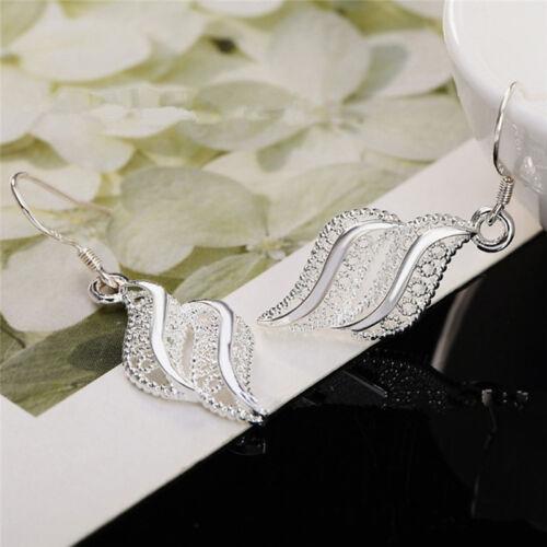 Silver Entonado Mujeres Damas huecos Gota Colgante Gancho Pendientes Encanto Joyas Z