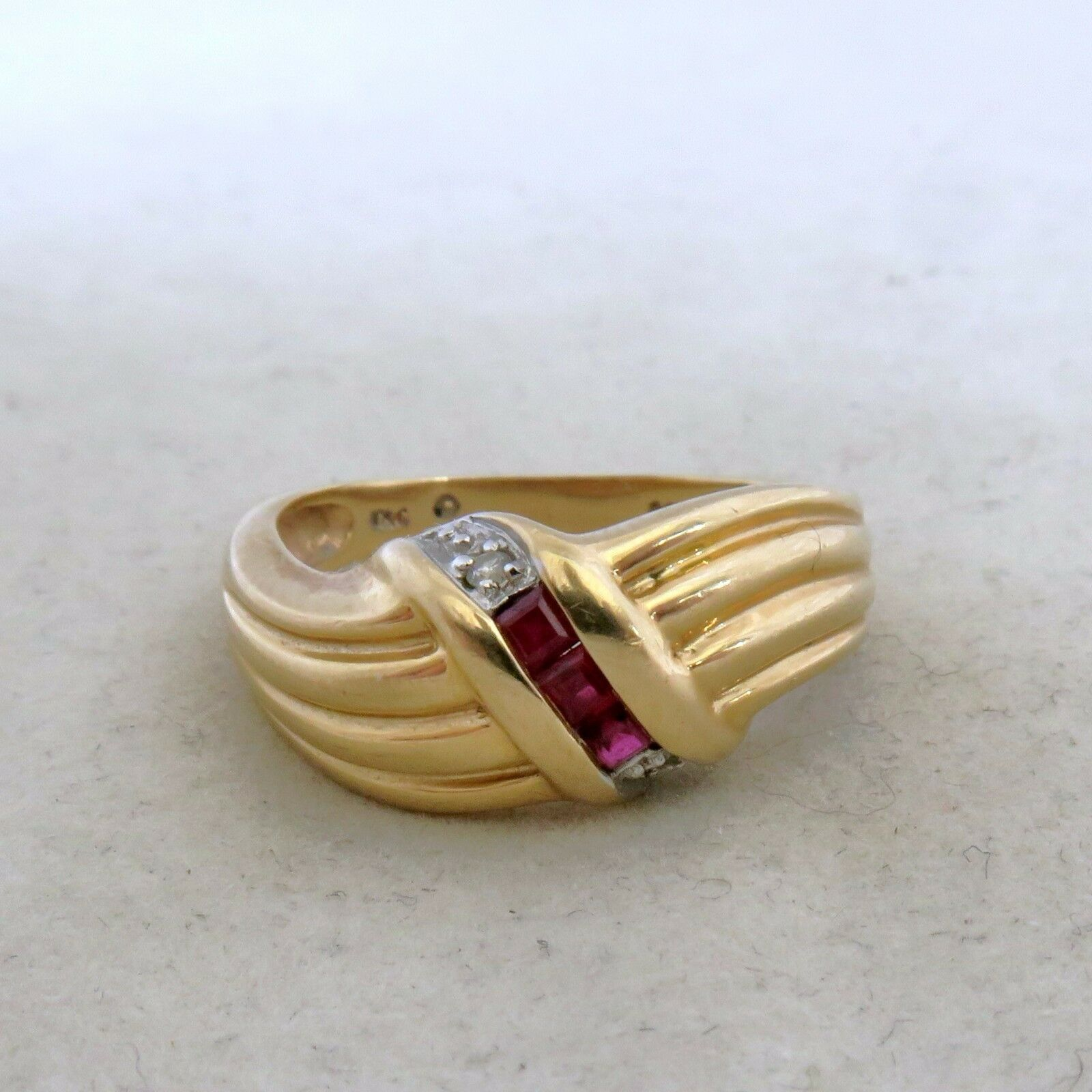 14K Yellow gold Ruby Ring with 3 Rubies & 2 Diamonds  (4.8 grams, size 7.25)