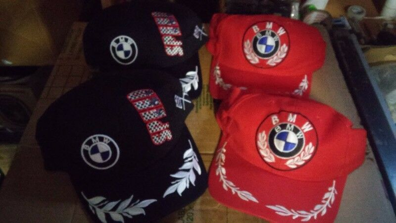 assorted  embroided peak caps and hats