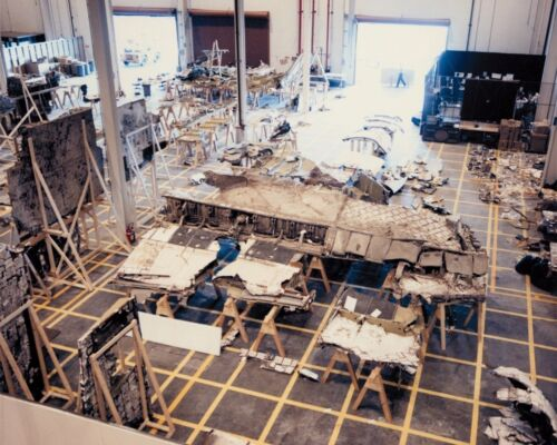 Recovered debris of Space Shuttle Challenger orbiter in hangar Photo Print