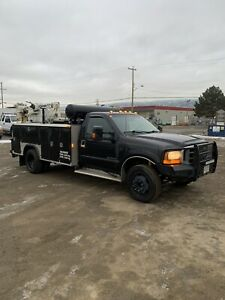 2000 F450 service truck with crane and air comp