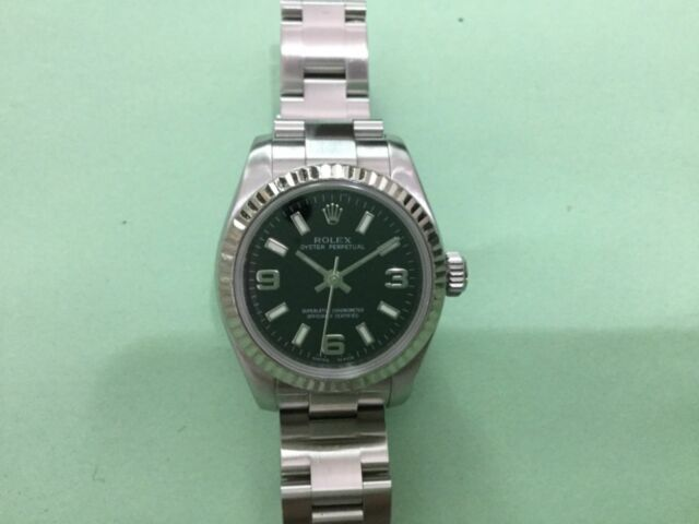 Rollex oyster perpetual ladies watch in stainless steel 18kt white gold bezel .