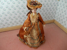 VICTORIAN LADY DOLL DRESSED IN BRASS COLOUR FOR A DOLLS HOUSE