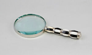 9977473-Silver-Colored-Magnifying-Glass-Nickel-Plated-Perlmutt-Griff