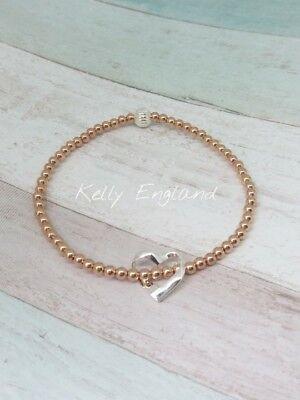Sterling Silver Stretch Bracelet with Rose Gold Filled Floating Heart