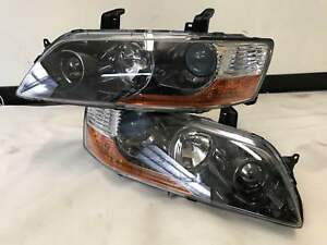 Details about Brand new Genuine Mitsubish Lancer Evo 9 head light assembly  HID  left and right