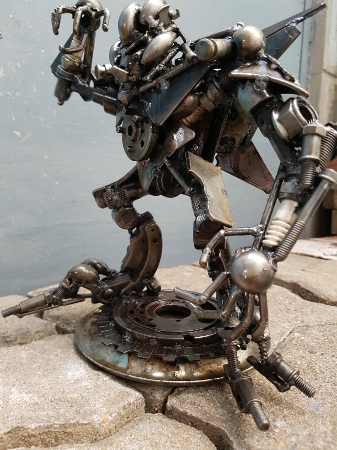 Transformers, araña Roja, astilla de hierro, escultura, papel a mano