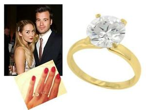 3.68 TCW Cubic Zirconia 18k Gold over .925 Silver Halo Ring