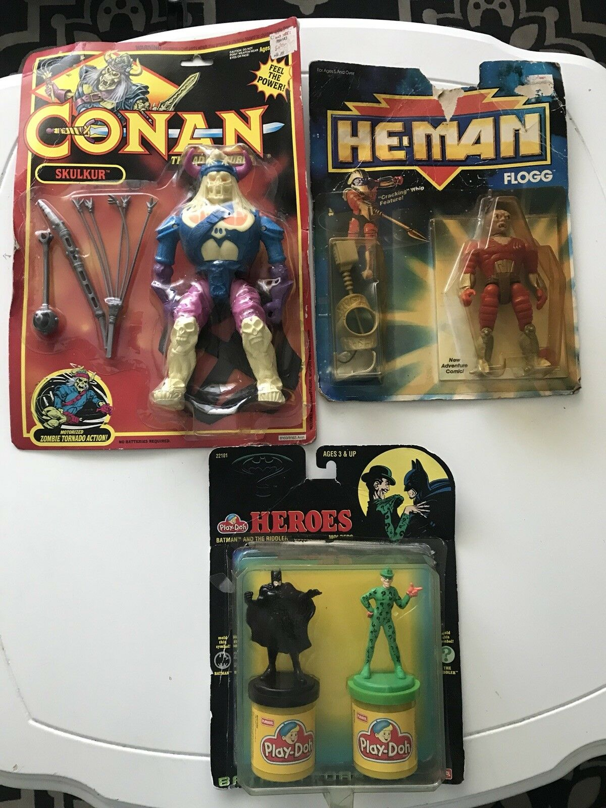 VINTAGE LOT OF THREE  3  1990'S TOYS HE-MAN FLOGG BATMAN PLAY-DOH & CONAN NIP