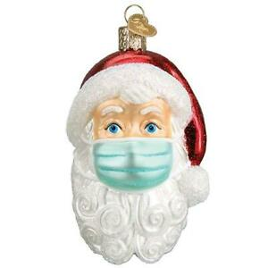 Old World Christmas SANTA WITH FACE MASK (40319)N Glass Ornament w/ OWC Box