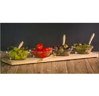 Serving Bowls On Wooden Board With Spoons
