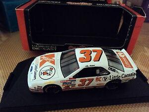 Quartzo-1-43-Ford-Thunderbird-37-NASCAR-K-Mart-Little-Caesars