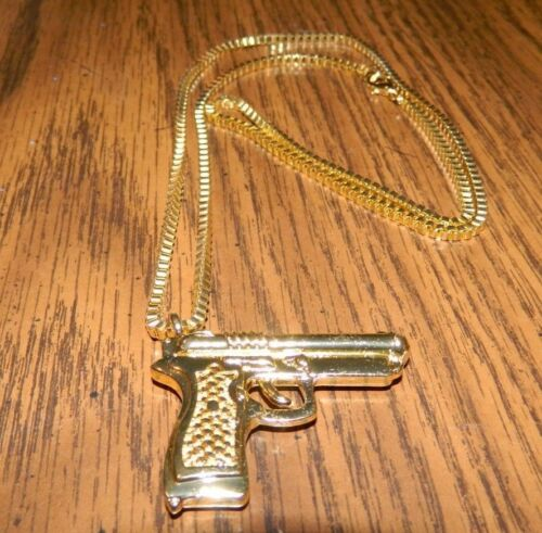 Gold Tone Hand Gun designed pendant with a matching 24 inch link chain MIP