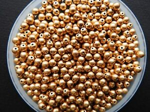 Czech glass gold round beads 4 mm pack of 100