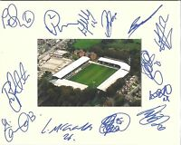 A 10 x 8 inch mount personally signed on 12.04.12 by 13 of the Bury squad.