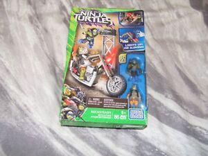 Aimable Mega Bloks Teenage Mutant Ninja Turtles Tmnt 2 Movie Rocksteady Moto Attaque 82pc-afficher Le Titre D'origine Approvisionnement Suffisant