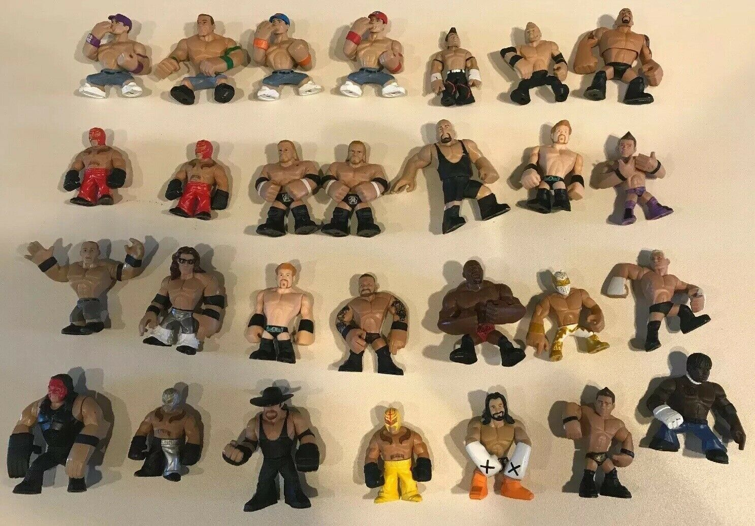 LOT OF 28 WWE WRESTLING MINI ACTION FIGURES