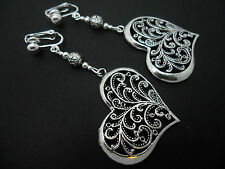 A PAIR OF  TIBETAN SILVER BIG HEART THEMED  CLIP ON  EARRINGS. NEW.