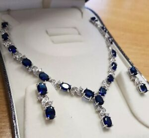 White-gold-finish-oval-blue-sapphire-and-created-diamond-earrings-and-necklace