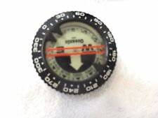 Oceanic compass needing service 50% of the fluid is missing.