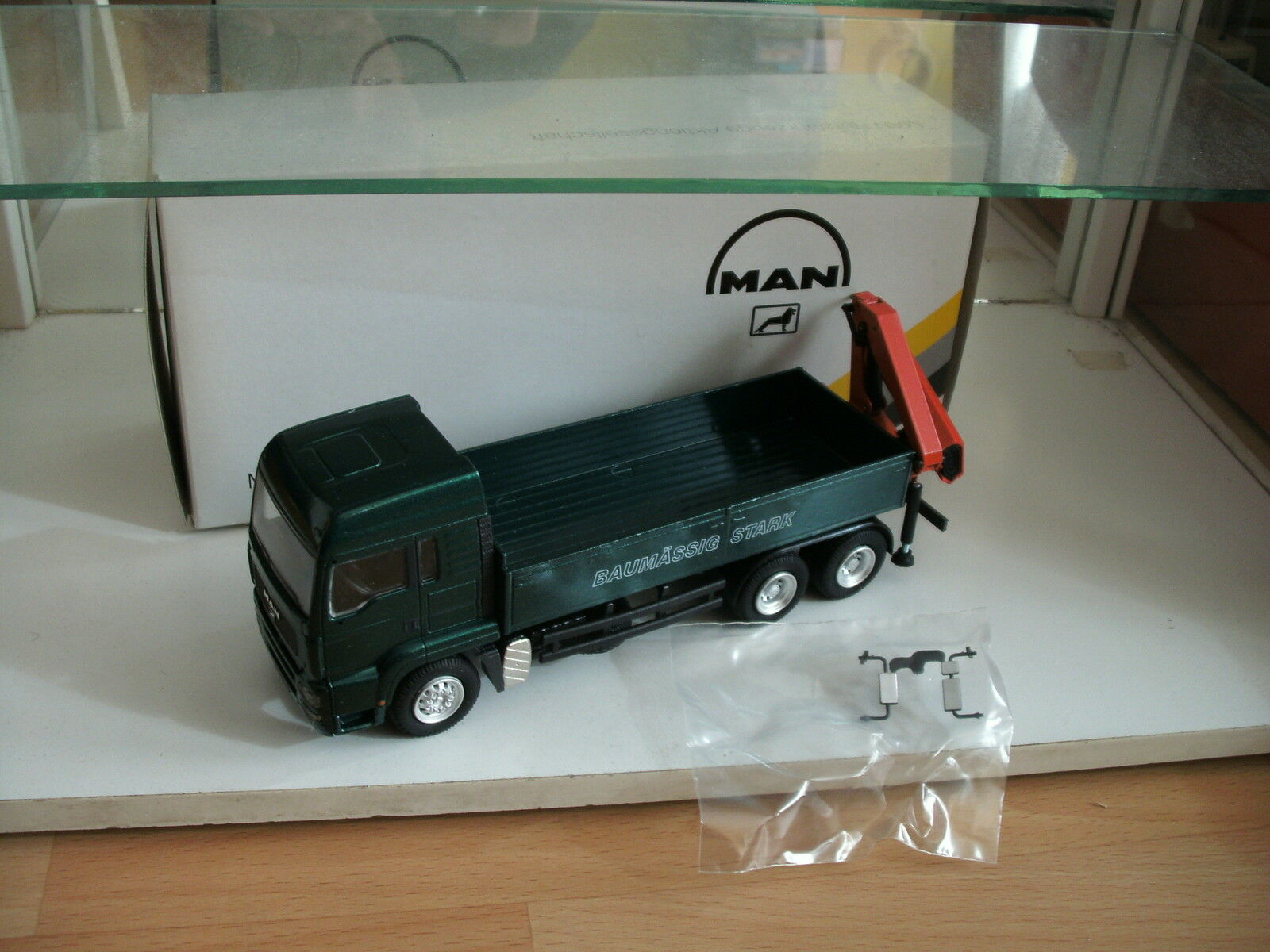 Conrad MAN Baumassig Stark with Crane in Green on 1 50 in Box