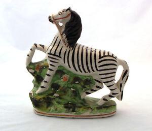 Antique-Staffordshire-ceramic-Zebra-pottery-Victorian-Era-glazed-animal-figure