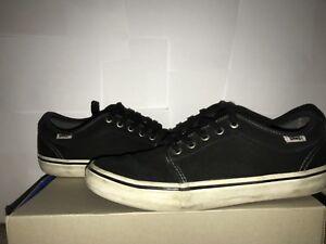 Super generic, beat up black Vans shoes