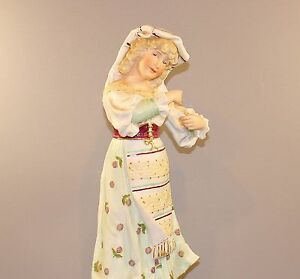 ANTIQUE-GERMAN-BISQUE-FIGURINE-OF-LADY-WITH-FLORAL-PRINT-DRESS