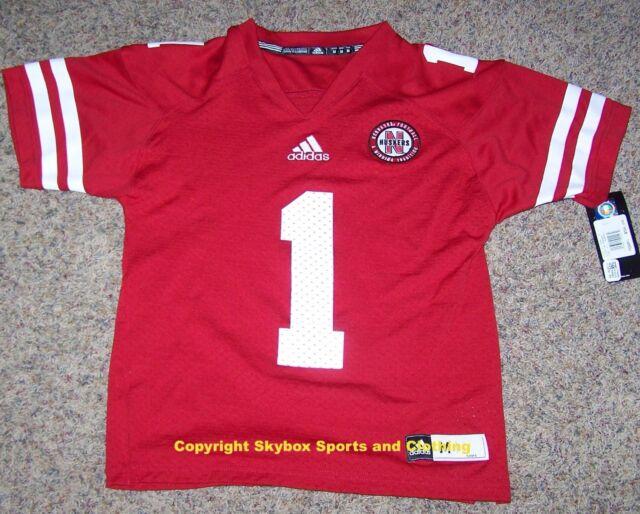 7ed14f5cbe5 New - Nebraska Cornhuskers adidas  1 Home Football Jersey - Boy s Sizes