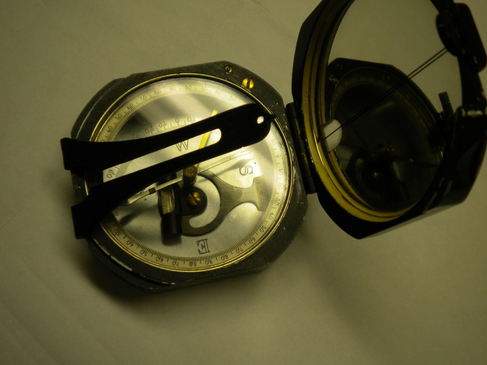 K & E land Surveyors Compass Pat.  Feb 2, 1926 with bi-pod connector  not to be missed!