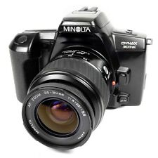 Cámara SLR Minolta Dynax 303si Vintage de película de 35mm con Lente 35-80mm af defectuoso