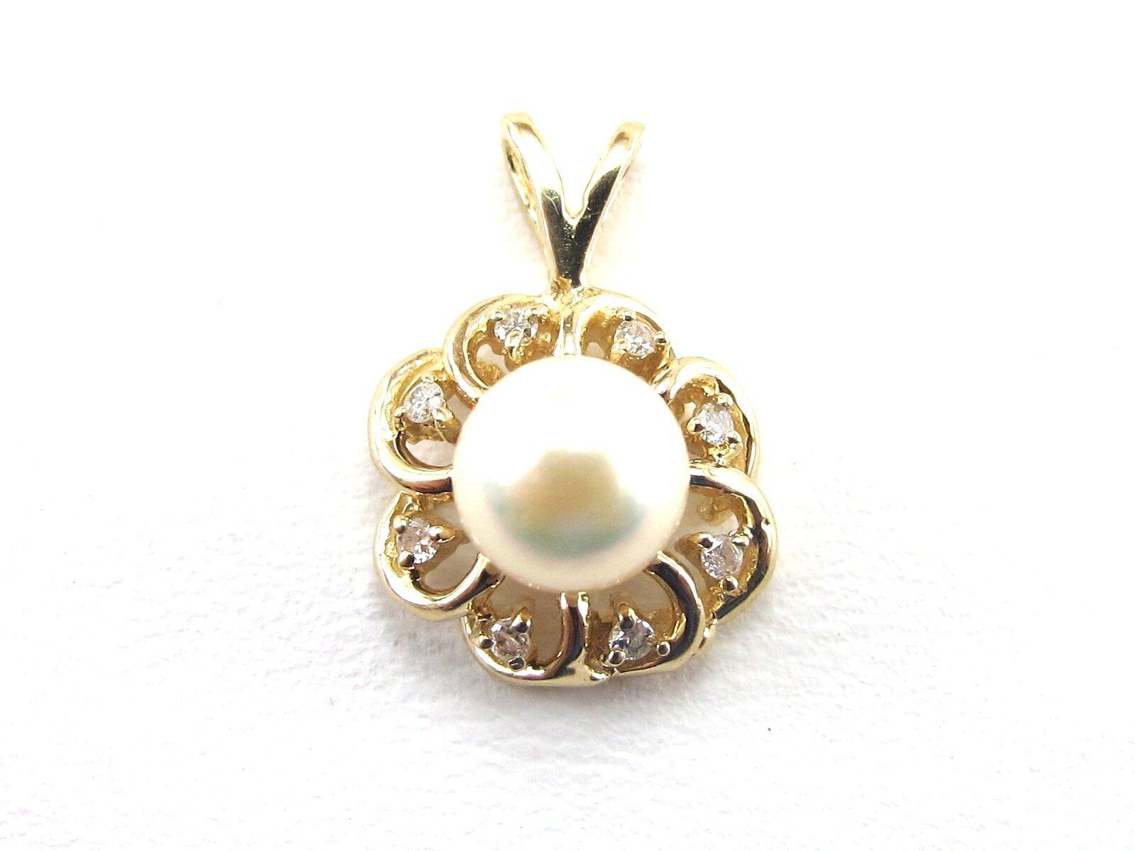14k Yellow gold Diamond And  Pearl Pendant