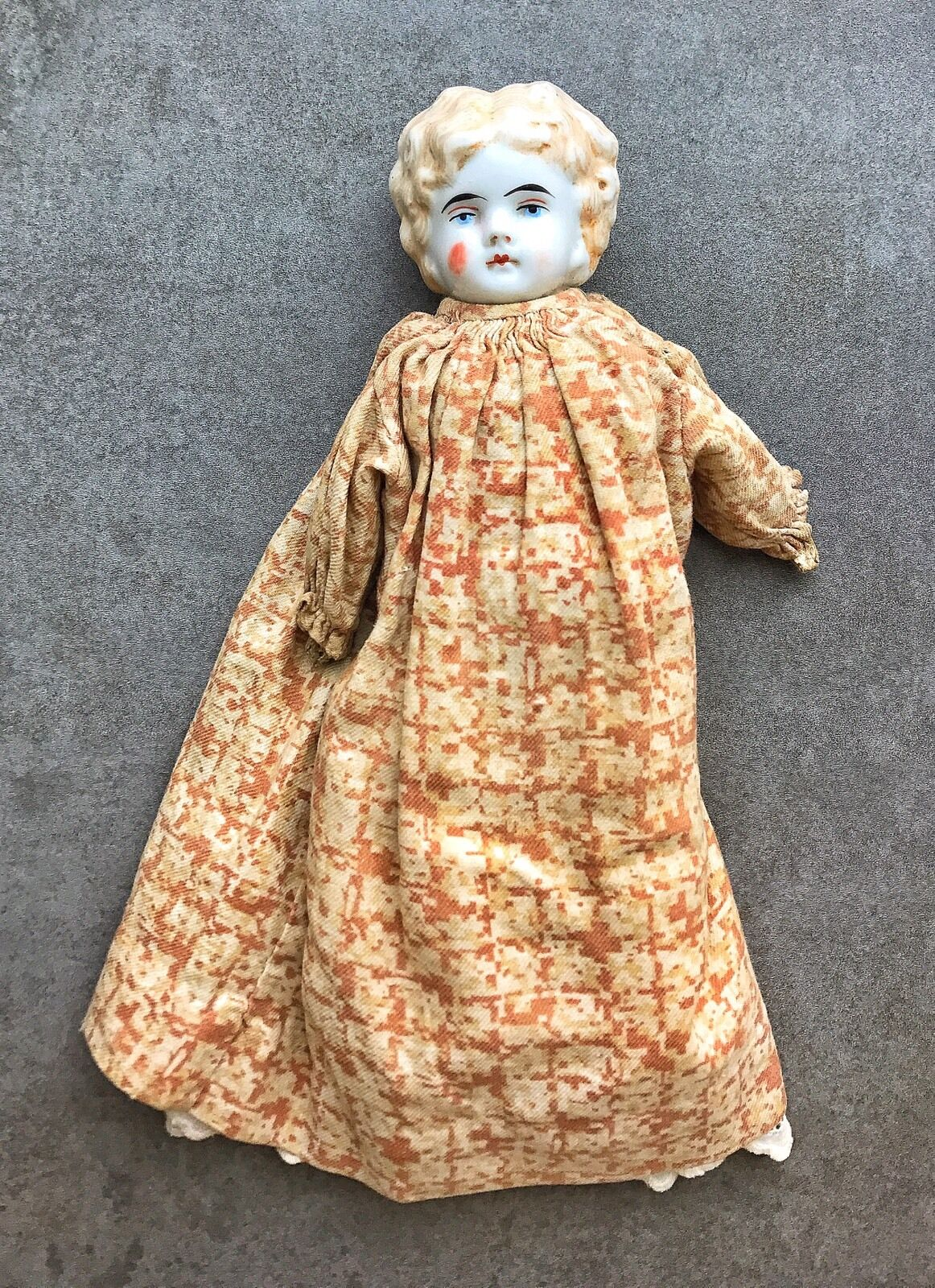 An Antique Porcelain Head Doll