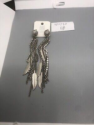 Ships USPS first class mail Vintage Silvertone dangle pierced earrings Pre owned.