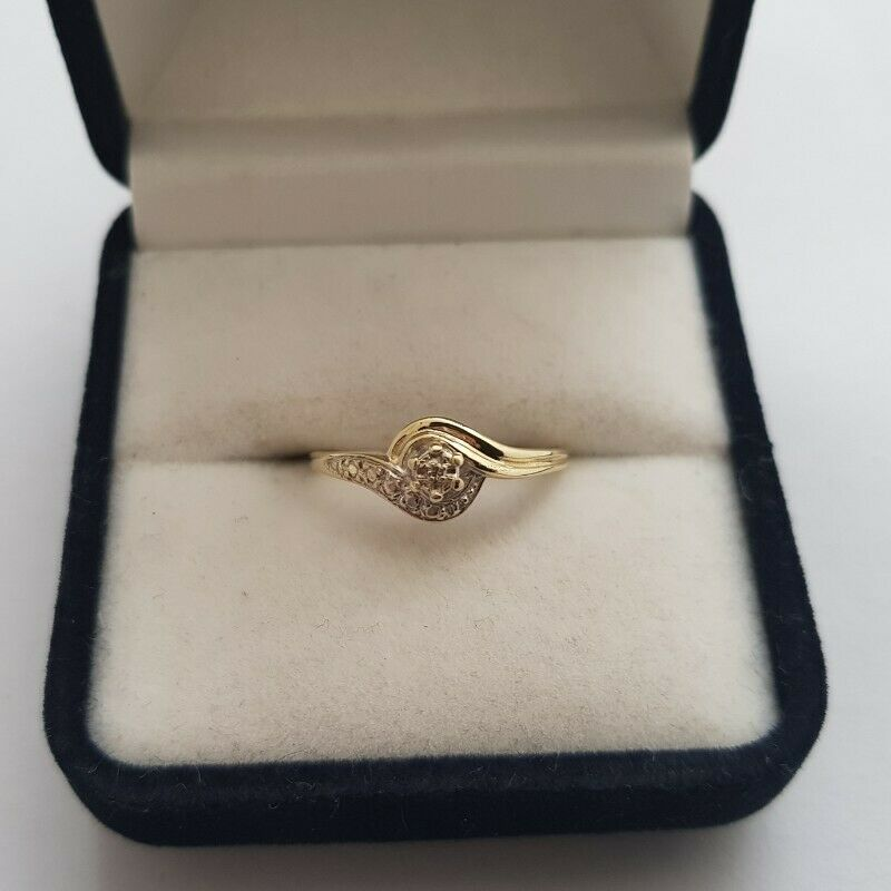A272 9k Gold Swirl Ring