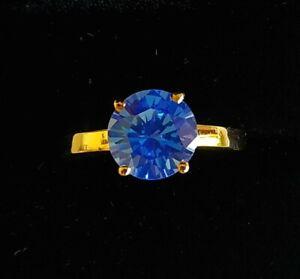 BRIGHT-BLUE-TOPAZ-ENGAGEMENT-RING