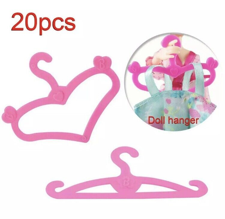 E-Ting 50 Pcs Pink Plastic Little Hangers For Girl Doll Dress Clothes Gown Doll