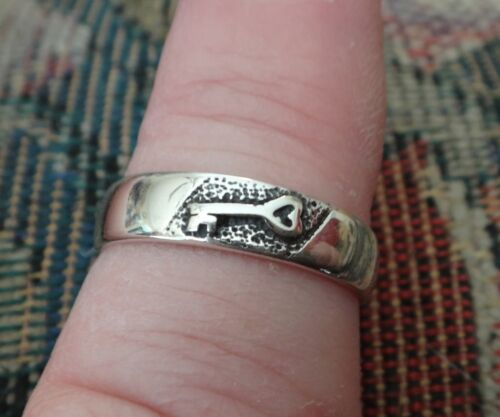 Sterling Silver 3 gram Tiny heart topped key on 5mm wide wedding band Ring